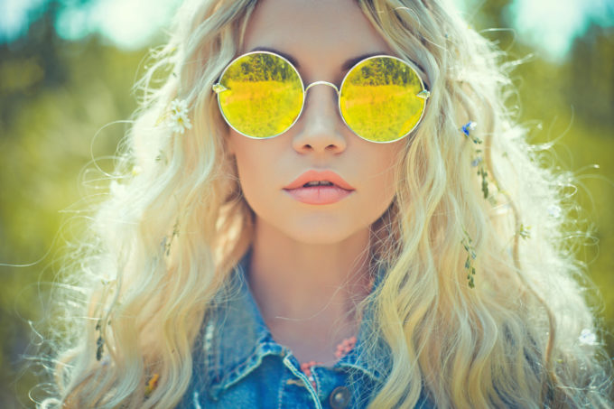 Fashion portrait of young hippie woman in summer sunny day
