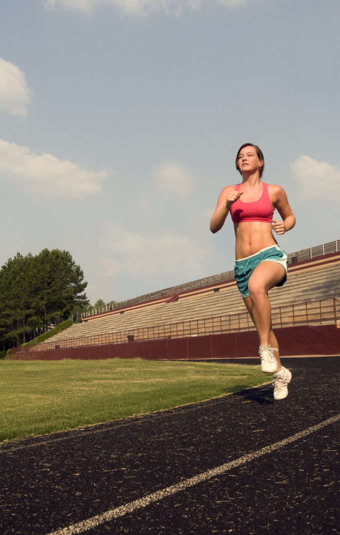 healthy-young-woman-running-outdoors-on-a-track-pv