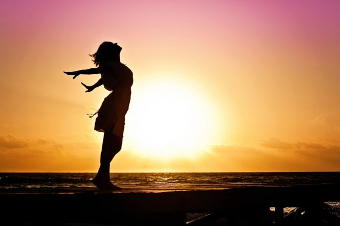 woman-happiness-sunrise-silhouette